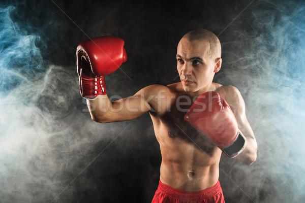 Młody człowiek kickboxing niebieski dymu młodych mężczyzna Zdjęcia stock © master1305