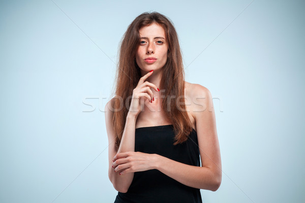 The thoughtful woman on gray background Stock photo © master1305