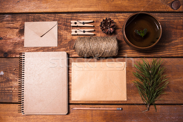 Notebook for recipes, paper envelopess, rope and clothespins on wooden table. Stock photo © master1305