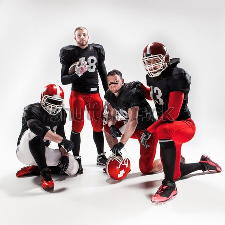 öt amerikai futball játékosok pózol labda Stock fotó © master1305