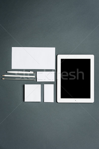 Stock photo: Mock-up business template with cards, papers, tablet. Gray background.