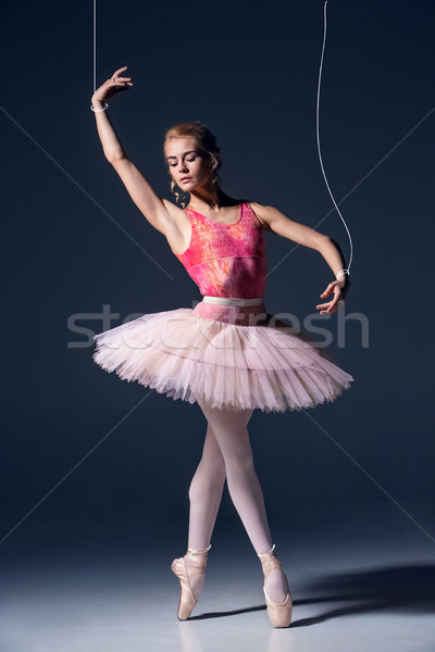 ballet dancer as puppet dancing over gray background Stock photo © master1305