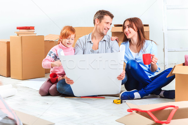 Stock photo: The happy family  during repair and relocation