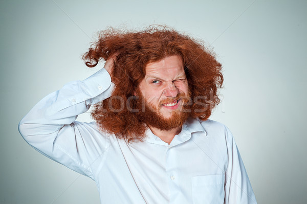 Stock photo: The young man rubbing his head