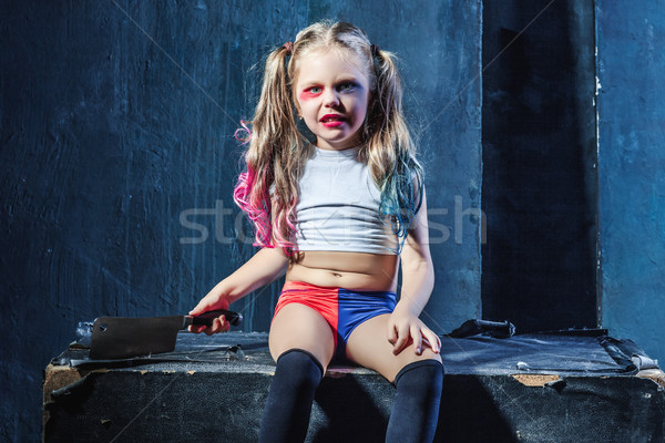 Horror shot: a scary evil girl with bloody knife Stock photo © master1305