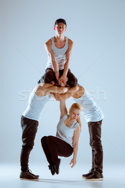 Group of men and women dancing hip hop choreography Stock photo © master1305