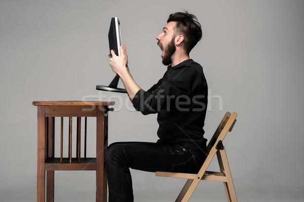 Vicces őrült férfi számítógéphasználat szürke kezek Stock fotó © master1305