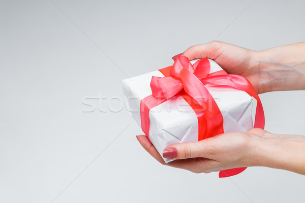 Stock photo: Female hands holding gift box