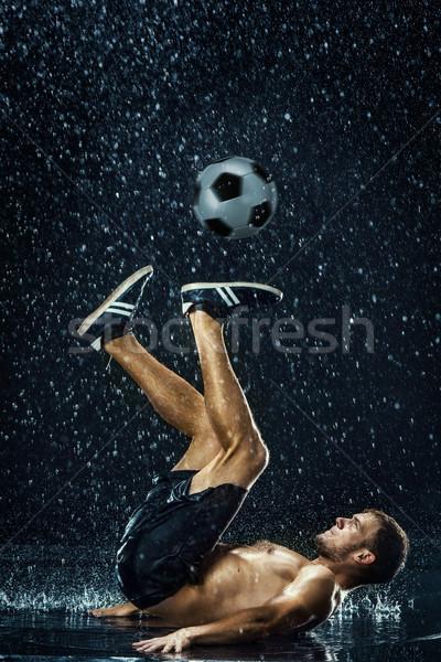 Vízcseppek körül futballista víz fekete férfi Stock fotó © master1305