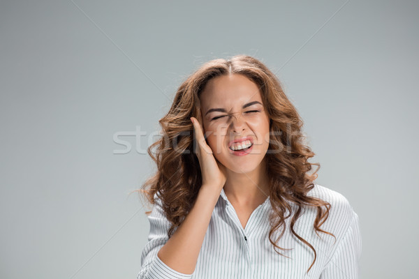 The young woman with earache over gray Stock photo © master1305