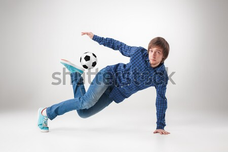 Portré fiatalember gyakorol jóga futball labda Stock fotó © master1305