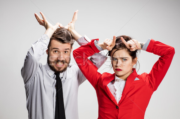 The business man and woman communicating on a gray background Stock photo © master1305