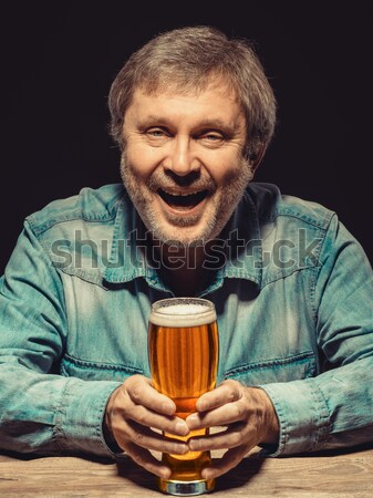 The enchanted and emotional fan with glass of beer Stock photo © master1305