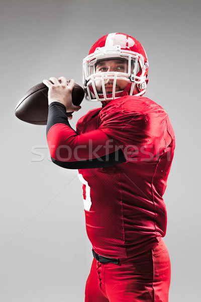 American football player posing with ball on white background Stock photo © master1305