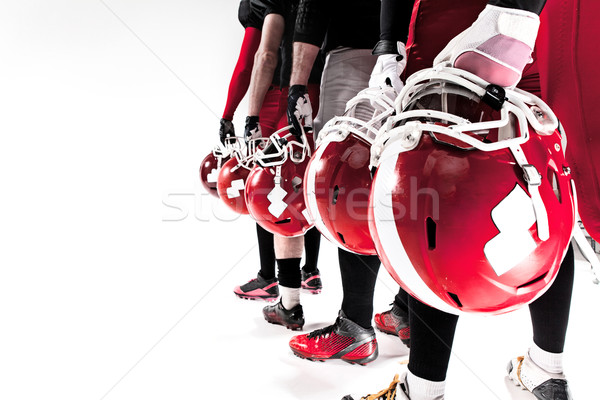 The hands of american football players with helmets on white background Stock photo © master1305