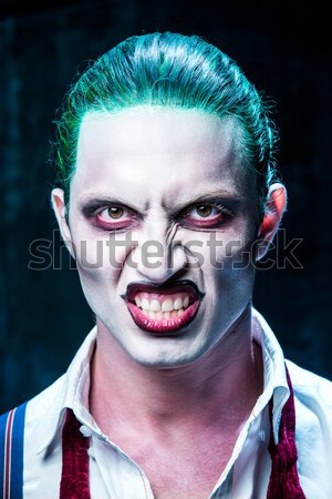 The scary clown and electric drill on dack background. Halloween concept Stock photo © master1305