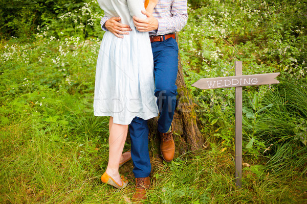 The crop image of romantic couple with green grass Stock photo © master1305
