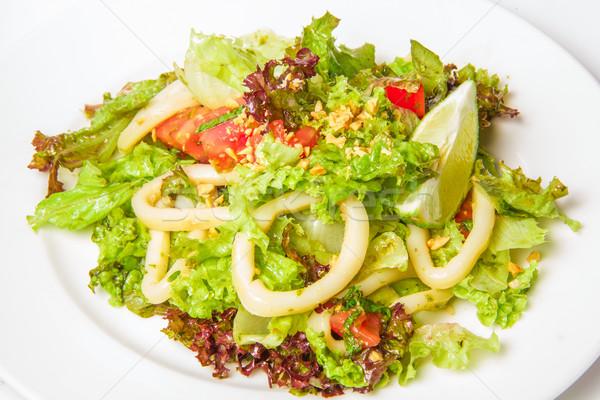 Deniz ürünleri salata halkalar kalamar domates nane Stok fotoğraf © master1305