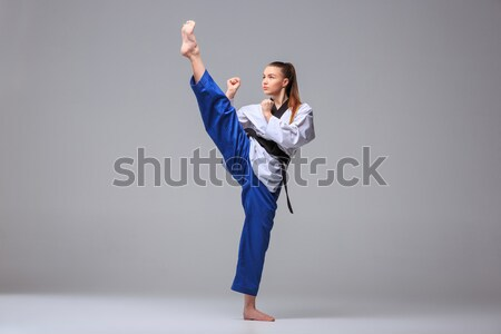 Stock photo: The karate girl with black belt