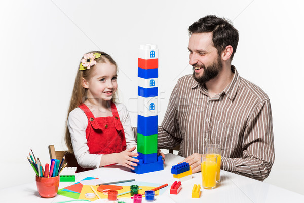 Stock photo: Father and daughter playing educational games together