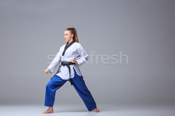 The karate girl with black belt  Stock photo © master1305
