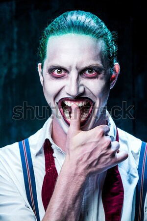 Terrible clown and Halloween theme: Crazy red clown in a shirt with suspenders Stock photo © master1305