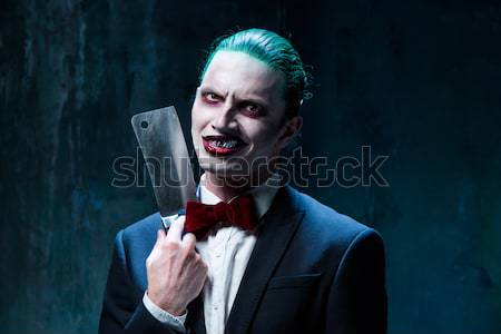 The scary clown holding a knife on dack. Halloween concept Stock photo © master1305