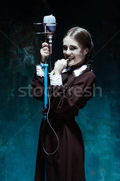 Porträt junge Mädchen Schuluniform Vampir Drop Stock foto © master1305