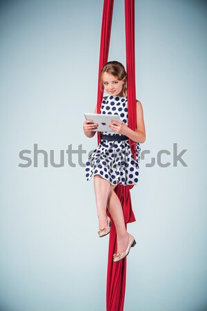 Graceful gymnast sitting with laptop Stock photo © master1305