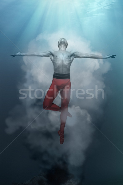 Stock photo: Young and stylish modern ballet dancer on fantasy background