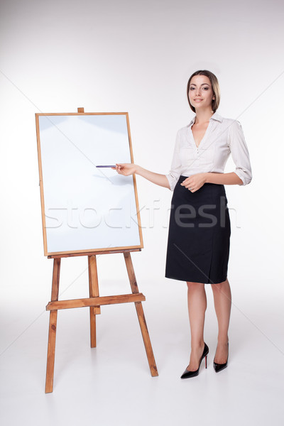 Genç iş kadını bir şey beyaz tahta Stok fotoğraf © master1305