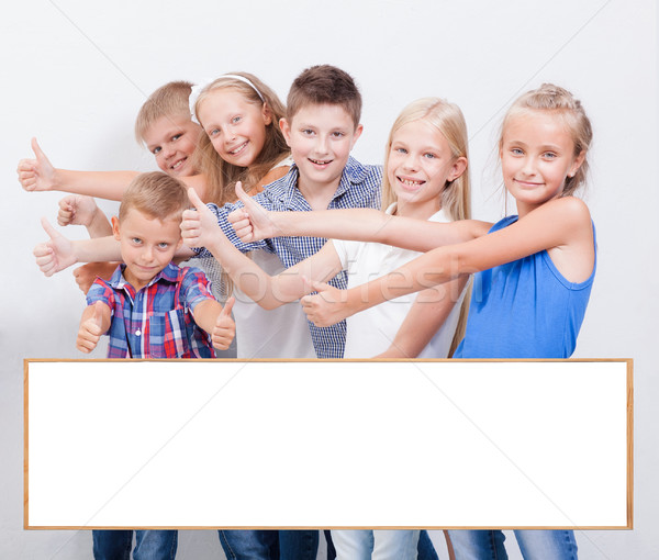 The smiling teenagers showing okay sign on white  Stock photo © master1305