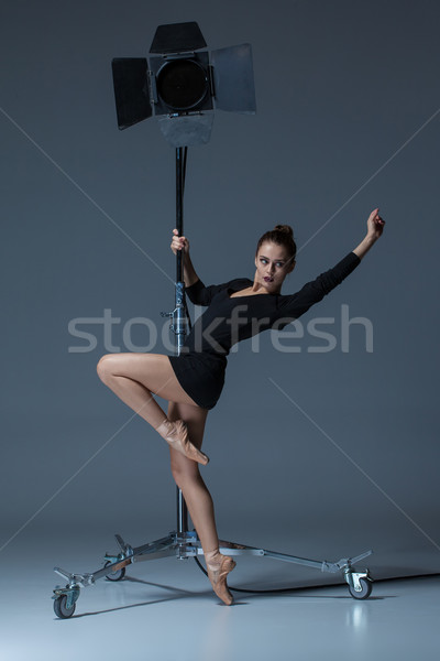 The beautiful ballerina posing on dack blue background   Stock photo © master1305