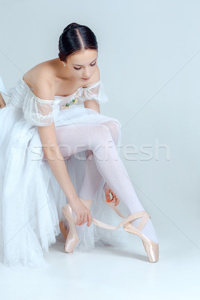 Professional ballerina putting on her ballet shoes Stock photo © master1305