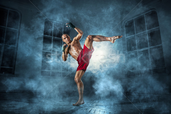 Giovane kickboxing giovani maschio atleta blu Foto d'archivio © master1305