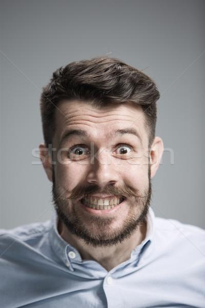 Człowiek patrząc bać szary niebieski Zdjęcia stock © master1305