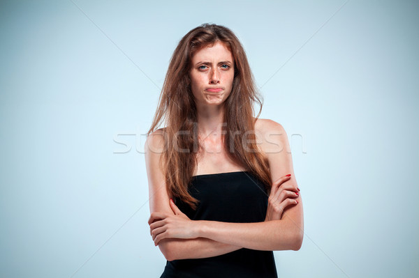 The disgusted and frowning young woman Stock photo © master1305