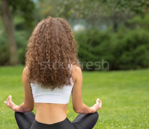 Сток-фото: красивая · женщина · сидят · назад · йога · медитации · Lotus