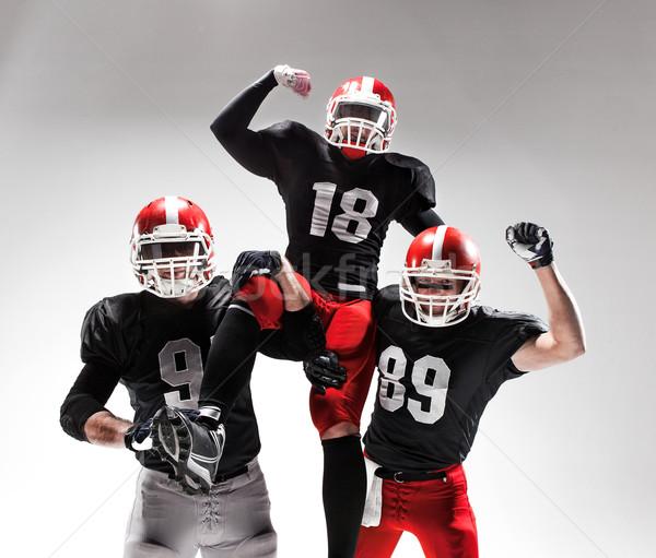 три американский футбола позируют белый Сток-фото © master1305