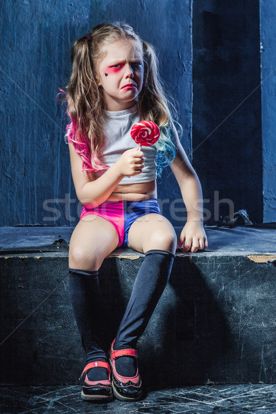 The crasy girl with candy on dark background Stock photo © master1305