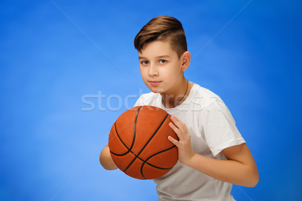 Stock photo: Adorable 11 year old boy child with basketball ball