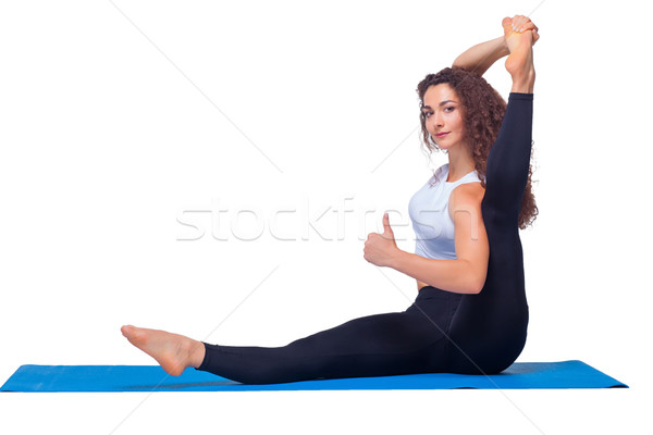 Studio shot of a young fit woman doing yoga exercises. Stock photo © master1305