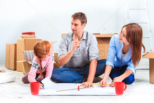 The happy family  at repair and relocation Stock photo © master1305