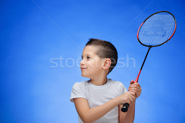 The boy with badminton rackets outdoors Stock photo © master1305