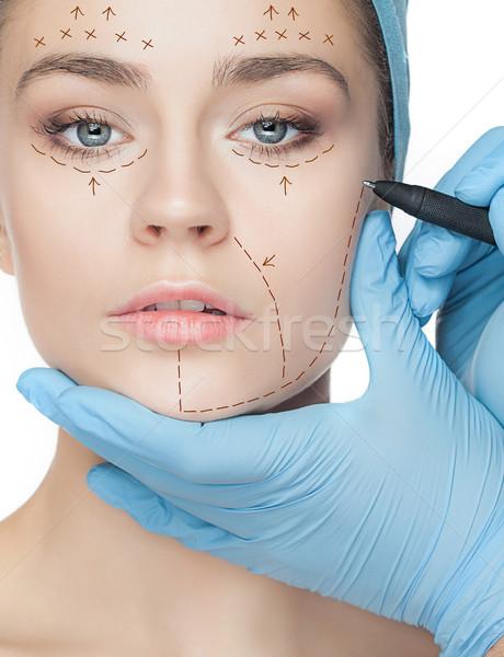 Mooie jonge vrouw perforatie lijnen gezicht plastische chirurgie Stockfoto © master1305