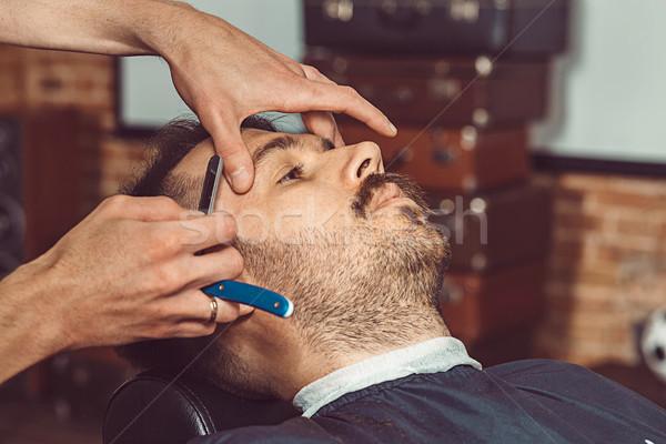 Cliente barbero tienda manos jóvenes Foto stock © master1305