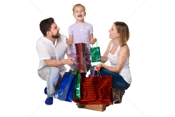 Happy family with shopping bags standing at studio  Stock photo © master1305