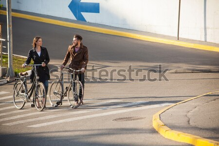 Young couple with a bicycle opposite city  Stock photo © master1305