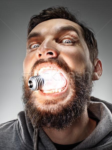 Caucasiano homem bulbo boca cinza engraçado Foto stock © master1305