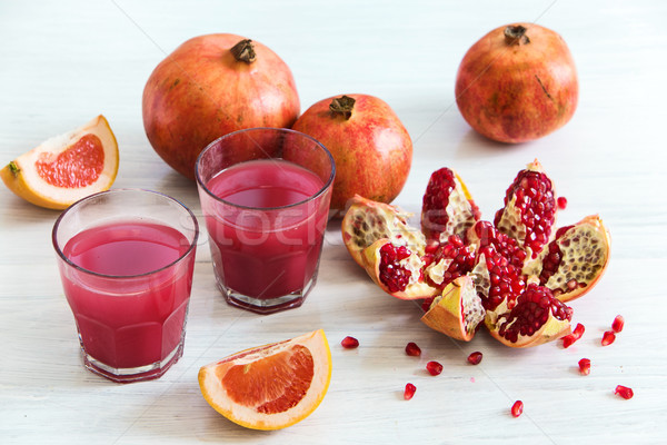 Pomegranate liqueur in a glasses on wooden table. Selective focus. Stock photo © master1305